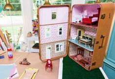 Take your old suitcase, or snag one at a thrift store, and make this super cool - and easy to transport dollhouse.