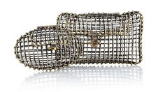 Metal Cage Clutches By Anndra Neen  Handmade by blacksmiths in Mexico, each cage clutch is one-of-a-kind.
