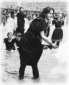 1900:  By the end of the 19th century people were flocking to the oceanside beaches for popular seaside activities such as swimming, surf bathing, and diving. The clumsy Victorian-style bathing costumes were becoming burdensome. A need for a new style bathing suits that retained modesty but was free enough to allow the young lady to engage in swimming was obvious.
