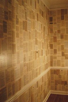 wallpapering with book pages.