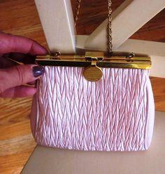 Vintage La Regale Pink Hand Made Evening Bag in Gold Frame. $19.99, via Etsy.