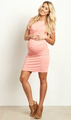 This not so basic maternity dress is everything we love: simple, elegant, and stylish. Perfect to dress up or down for any occasion, this fitted maternity dress is oh-so-soft and its short sleeves are perfect for warm weather. Slightly ruched sides hug just the right places, while a fitted style shows off your growing baby bump.