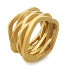 Sheri Beryl.  Hand forged from a single continuous piece of heavy gauge wire.  18K Gold plate.