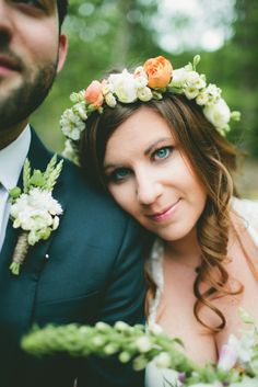 I was checking out the boutonniere on the guy here, although I do like the headpiece too.  May flower crown with ranunculus