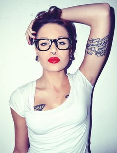 wear suits - lady and tattoos and specs.