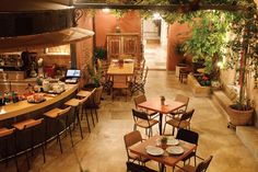 Where to go for late-night fun in Athens, from buzzy rooftops to fairy-lit courtyards