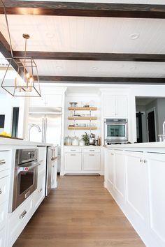 Cambria carrick quartz countertop with dark grey for Sanibel white kitchen cabinets