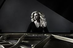 Me at my piano in my living room with backdrop and fan blowing my hair - one soft box light to my right - Website Photo Shoot.  Jennifer Thomas www.jenniferthomasmusic.com  Copyright 2011 Ron Southworth Photography