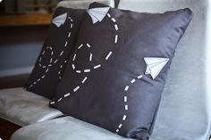 living room want.  paper airplane pillows!  swap out black pillows for purple and we're set.