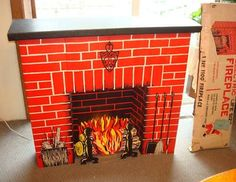 Vintage cardboard fireplace! We had one.  Lightbulb behind the red plastic for flames!