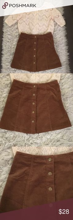 NWOT brown suede button up skirt 😍 Never worn! Great condition has been sitting in my closet for a year ( small mark as shown in third pic not noticeable - willing to negotiate on price). Love the gold button detail! This listing is for the skirt only, the shirt is available separately! Urban Outfitters Skirts