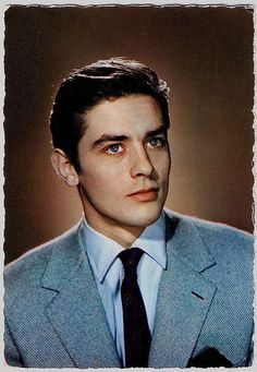 Alain Delon    French postcard by Mexichrome, no. 13. Photo: Sam Lévin.    In the late 1950's and early 1960's Alain Delon (1935) was the breathtakingly good-looking James Dean of the French cinema. The 'male Brigitte Bardot' soon proved to be a magnificent actor in masterpieces by Luchino Visconti and Michelangelo Antonioni.
