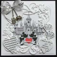 Order code: 071709 Disney themed 60th Wedding Anniversary card, with glittery diamond shapes and glittery hearts. Metal hearts and princess castle charms hanging from a pretty, silver, organza bow.