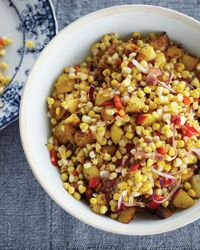 Warm Corn Chowder Salad with Bacon and Cider Vinegar -  In this riff on corn chowder, the Beekman boys toss corn, potatoes and bacon with cider vinegar. They grow at least five varieties of sweet corn each summer, and they're always coming up with new ways to use it. Because the corn for this salad is barely cooked, it's best to use the juiciest kernels available.