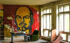 Abandoned Theme Parks in America | Other photos show an abandoned theatre, with the face of Lenin painted ...