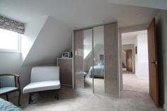 Helping hide away clutter, mirrored wardrobes were a great addition to help the bedroom appear larger