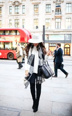 Chunky Cable Knit Sweater In London | oversized sweater, leggings, buffalo plaid scarf, Celine handbag, Stuart Weitzman over-the-knee boots, wide brim hat | The Sweetest Thing | black and white outfit