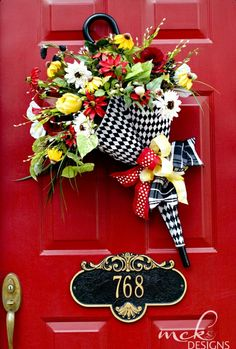 Gorgeous umbrella door decoration in black and white with red and yellow accents. A stunner! #wreath #umbrellawreath