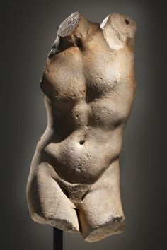 "A Torso of the Apollo Sauroktonos - This life-size torso derives from a fine quality marble copy of a celebrated Greek original in bronze of the mid-4th century B.C., the so-called Apollo Sauroktonos (""Lizard-Slayer""), whose creation is attributed to the Athenian sculptor Praxiteles, perhaps best known, past and present, for his revolutionary depiction in marble of Aphrodite  Marble, Greek, late 2nd c BC"