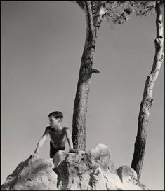 """Athens, Greece, 1937. """"Spirit of Lycabettus."""" Photographs of mortals, stones and spirits by Herbert List. Haunting, mystical, epic, and sometimes funny. Above, Lycabettus. Above, the shadows of Poseidon's Temple. Above, Santorini Island, 1937. """"The captive fish in its bowl and the open sea symbolize man who, being tied to earth, can never quite break free...  Read more »"""