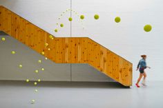 Suspended Tennis Balls in the Mustang Art Gallery, in Alicante, Spain, by Ana Soler.