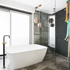 Shay and Dean's master bathroom offering on The Block 2015, featuring the Herringbone Nero Mosaic and Arkitek Grey tiles.