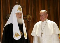 Pope Francis (R) looks at Russian Orthodox Patriarch Kirill during their meeting in Havana, February 12, 2016. REUTERS/Max Rossi        TPX IMAGES OF THE DAY          - RTX26PAM