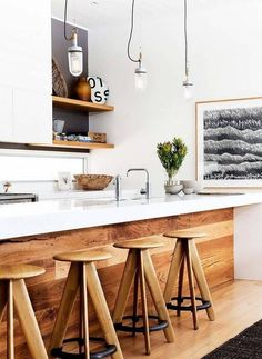rustic interiors white kitchen with wood paneled island #kitchendesign