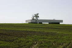 The building is an enigmatic white bar in the remote landscape