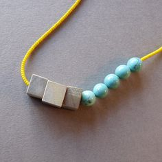 Wooden beaded necklace in yellow turquoise black and por bhmakes