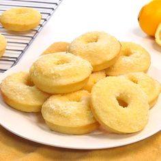 Lemon Sugar Baked Donuts ~ light, citrusy, and generously coated in a crunchy, lemon-zest infused sugar…the perfect sunny treat for breakfast or dessert! | FiveHeartHome.com #bakeddonuts
