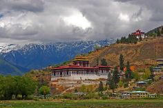 Bhutan Tour Packages: Buddhist monasteries, vibrant culture, monks draped in traditional attire and mountain beauty welcoming you at every step.