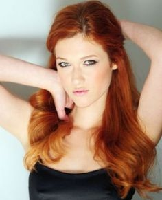 Nicole Fox...not sure if she qualifies as a celebrity but I love her and her red hair :)