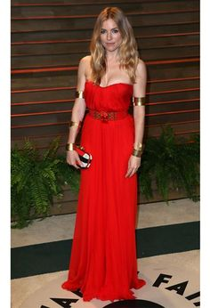 Sienna Miller striking in a red and gold Alexander McQueen get-up at the Vanity Fair Oscar Party, 2014.