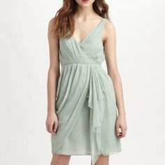 """Alice + Olivia Faux Wrap Drape Dress This wrap-style, v-neck silk-chiffon dress features a cascading ruffle at the front and pleating at the draped skirt. Ruching at empire waist. Exposed back zip, 1"""" straps, and jersey lining. Alice + Olivia Dresses Mini"""