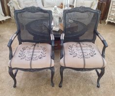 French style cane chairs - After Spray painted with Flat Black, distressed Recovered with New Grainsack Fabric and hand stenciled by me : )