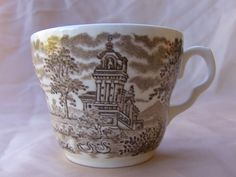 A  castle with swans.  EIT English Ironstone Renaissance Brown Pattern.  I've got 6 of these in my Bonanza Booth.    I can never decide if I like brown transferware or red better.  Or maybe blue?  Anyway, brown is very nice.