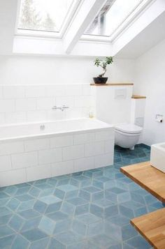 geometric tile blue block tile floor in white bathroom