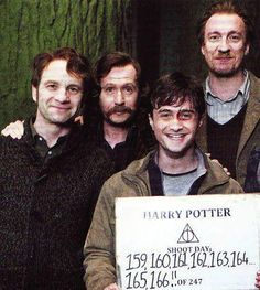 Harry, his dad, his godfather and his friend/old teacher