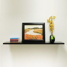 The Slim Floating Wall Shelf compliments any room and shows no visible support, making it appear to be floating.