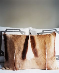 """""""fur throw pillow"""" @Jennie Hall hey you could do this with the skins we have around the house/in the attic/special boxes/wherever"""