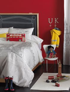 LOVE this London collection duvet for kids room.  chalkboard headboard against red walls.. love! blisslivinghome