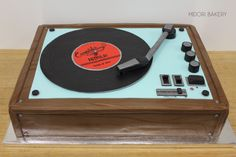 Custom Record Player cake with hand painted woodgrain base and handmade record and detailing by Midori Bakery.