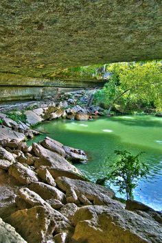 Hamilton Pool, a gorgeous natural pool filled with luminous green water, is capped by a limestone overhang covered with lush ferns and mosses. Camping In Ohio, Camping World, Dream Vacations, Vacation Spots, Great Places, Places To See, Hamilton Pool Preserve, Beautiful World, Beautiful Places