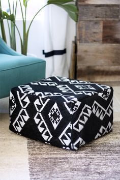 Want a spot to rest your feet without splurging on a budget-breaking buy? This DIY pouf from Kristi Murphy upgrades an IKEA footstool to create this geometric, black-and-white pouf.