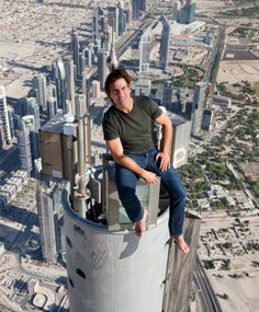 Tom Cruise sitting on the very top of the Burj Khalifa in Dubai during the filming of Mission Impossible 4. And he did his own stunts. Gotta give him credit...he has guts.