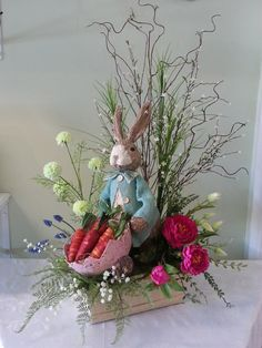 Liven up your home for Easter with this bunny heart! Liven up your home for Easter with this bunny heart! Created by Anna's Flowers Inc. Easter Table Decorations, Decoration Table, Easter Decor, Table Centerpieces, Decoration Crafts, Easter Ideas, Easter Tree, Easter Wreaths, Easter Flower Arrangements