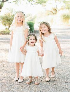 Flower girls in sweet, white dresses