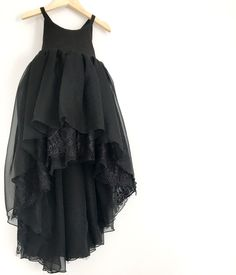This show stopper composed of layers of sheer black chiffon and delicate ornate lace was named after the iconic Audrey Hepburn character Eliza Dolittle. A tr