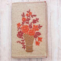 Flower Basket Junk Journal. Cross Stitched Cover. Handmade. Journal Cards, Junk Journal, Music Sheet Paper, Book And Magazine, Handmade Journals, Cross Stitch Flowers, Flower Basket, Vintage Books, Pattern Paper